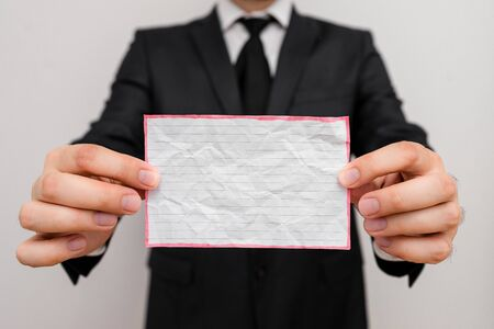 Male human wear formal work suit office look hold notepaper sheet use hand