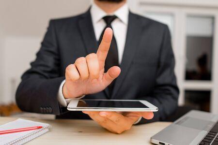 Male human wear formal clothes present presentation use hi tech smartphone