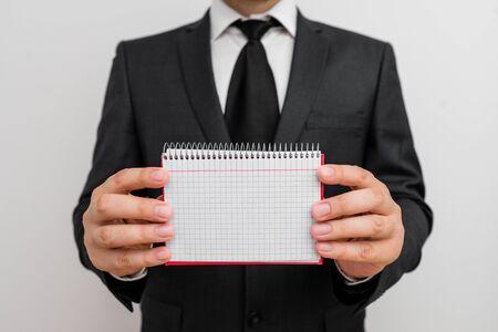 Male human wear formal work suit office look hold mathematics book use hand Reklamní fotografie