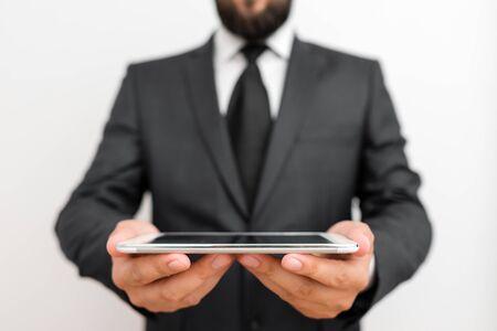 Male human wear formal work suit hold smart hi tech smartphone use hands
