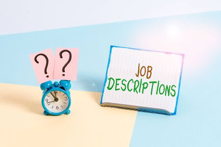 Conceptual hand writing showing Job Descriptions. Concept meaning a formal account of an employee s is responsibilities Alarm clock beside a Paper sheet placed on pastel backdrop