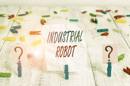 Handwriting text Industrial Robot. Conceptual photo robotic mechanism used in the fabrication of products Scribbled and crumbling sheet with paper clips placed on the wooden table Zdjęcie Seryjne