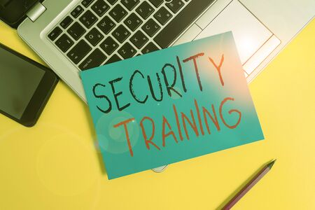 Writing note showing Security Training. Business concept for providing security awareness training for end users Metallic laptop small paper sheet pencil smartphone colored background