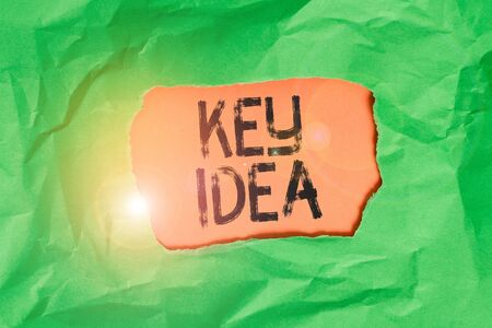 Handwriting text Key Idea. Conceptual photo Exceptional or vital thought or suggestion Without comparison Green crumpled ripped colored paper sheet centre torn colorful background