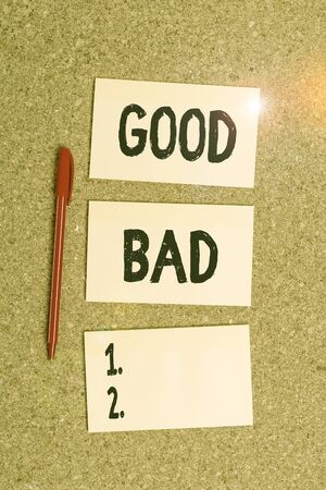 Conceptual hand writing showing Good Bad. Concept meaning to seem to be going to have a good or bad result Life choices Empty sticker reminder memo billboard corkboard desk paper Imagens