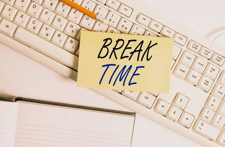 Word writing text Break Time. Business photo showcasing scheduled time when workers stop working for a brief period White pc keyboard with empty note paper and paper clips above white background