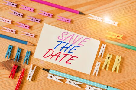 Handwriting text Save The Date. Conceptual photo Systematized events Scheduled activity Recorded Filed Colored clothespin papers empty reminder wooden floor background office Stockfoto - 134623436