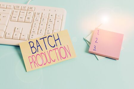 Text sign showing Batch Production. Business photo text products are analysisufactured in groups called batches Paper blue desk computer keyboard office study notebook chart numbers memo
