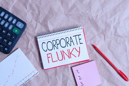 Text sign showing Corporate Flunky. Business photo text someone who works obediently for another demonstrating in company Papercraft craft paper desk square spiral notebook office study supplies Reklamní fotografie