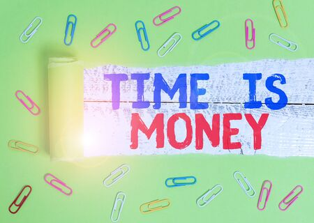 Text sign showing Time Is Money. Business photo text Better to do things as quickly as possible Do not delay Paper clip and torn cardboard placed above a wooden classic table backdrop