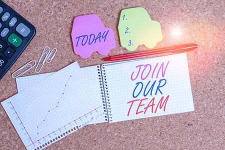 Text sign showing Join Our Team. Business photo text Hiring Vacancy Huanalysis resource recruitment Manpower hunt Desk notebook paper office cardboard paperboard study supplies table chart