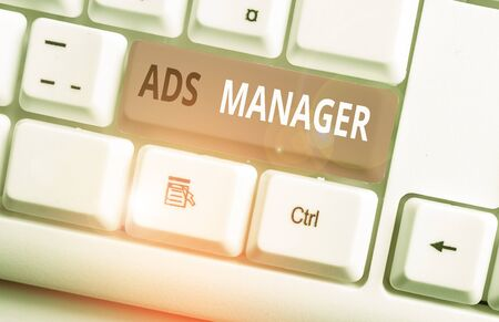 Conceptual hand writing showing Ads Analysisager. Concept meaning oversee and control the various advertising activities White pc keyboard with note paper above the white background