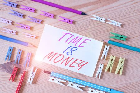 Handwriting text Time Is Money. Conceptual photo Better to do things as quickly as possible Do not delay Colored clothespin papers empty reminder wooden floor background office Stock Photo - 134624085