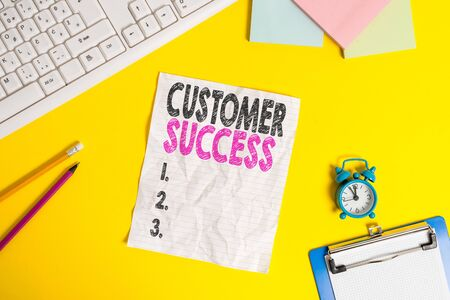 Text sign showing Customer Success. Business photo text customers achieve desired outcomes while using your product Copy space on notebook above yellow background with keyboard on table