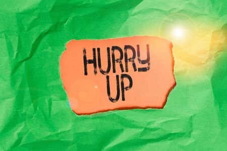 Handwriting text Hurry Up. Conceptual photo asking someone to do a job very fast Quickly Lets go Encourage Green crumpled ripped colored paper sheet centre torn colorful background Stock Photo