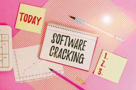 Text sign showing Software Cracking. Business photo showcasing modification of software to remove or disable features Writing equipments and computer stuffs placed above colored plain table