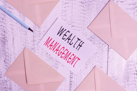 Conceptual hand writing showing Wealth Management. Concept meaning perforanalysisce tracking of the funds as per regular market Envelopes highlighter ruled paper sheet wooden vintage background Stock Photo
