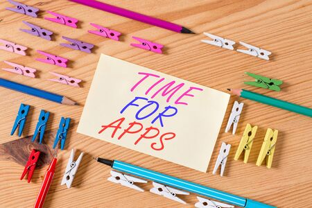 Handwriting text Time For Apps. Conceptual photo The best fullfeatured service that helps communicate faster Colored clothespin papers empty reminder wooden floor background office Zdjęcie Seryjne