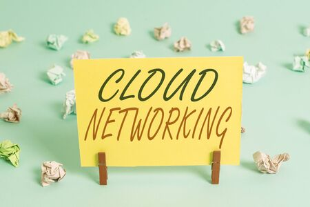 Text sign showing Cloud Networking. Business photo text sourcing and utilization of one or more network resources Colored crumpled rectangle shaped reminder paper light blue background 免版税图像