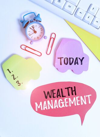 Writing note showing Wealth Management. Business concept for perforanalysisce tracking of the funds as per regular market Flat lay with copy space on bubble paper clock and paper clips