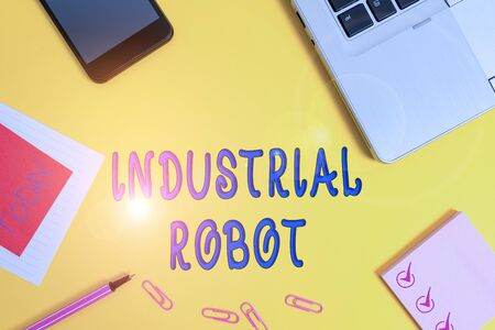 Text sign showing Industrial Robot. Business photo text robotic mechanism used in the fabrication of products Laptop smartphone notepad marker paper sheet note clips colored background Zdjęcie Seryjne