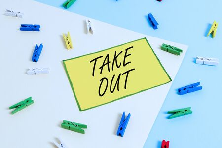 Word writing text Take Out. Business photo showcasing the act of taking out food food from the restaurant to eat outside Colored clothespin paper empty reminder yellow blue floor background office Stock Photo