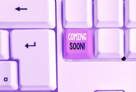 Text sign showing Coming Soon. Business photo showcasing event or action that will happen after really short time White pc keyboard with empty note paper above white background key copy space Stock Photo - 134734146