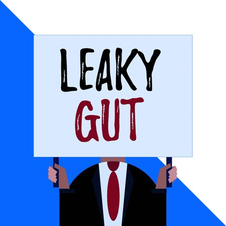 Conceptual hand writing showing Leaky Gut. Concept meaning A condition in which the lining of small intestine is damaged Man chest dressed dark suit tie face holding big rectangle Фото со стока