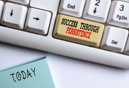 Conceptual hand writing showing Success Through Persistence. Concept meaning never give up in order to reach achieve dreams White pc keyboard with note paper above the white background