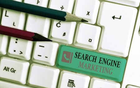 Word writing text Search Engine Marketing. Business photo showcasing promote Website visibility on searched result pages White pc keyboard with empty note paper above white background key copy space