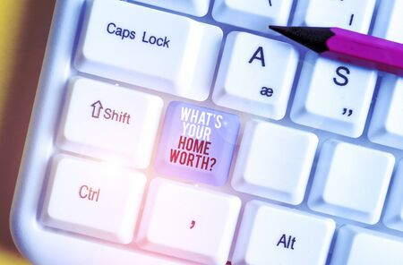 Conceptual hand writing showing What S Your Home Worth Question. Concept meaning Value of a house Property Cost Price Rate White pc keyboard with note paper above the white background Stock fotó