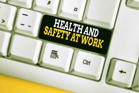 Writing note showing Health And Safety At Work. Business concept for Secure procedures prevent accidents avoid danger White pc keyboard with note paper above the white background Foto de archivo - 134733458