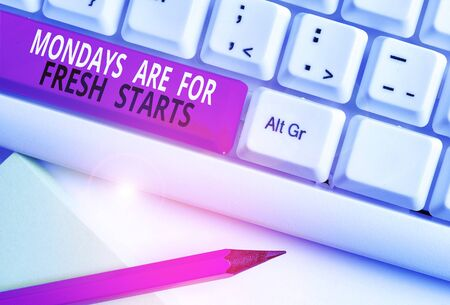 Conceptual hand writing showing Mondays Are For Fresh Starts. Concept meaning Begin again every week have a good morning White pc keyboard with note paper above the white background Reklamní fotografie