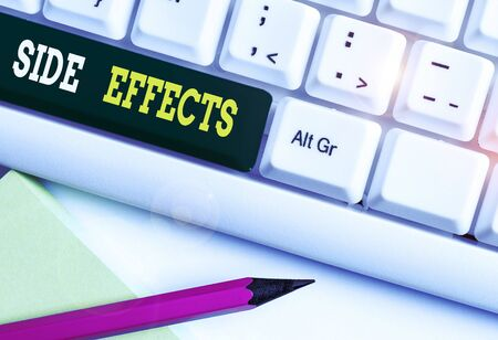 Conceptual hand writing showing Side Effects. Concept meaning secondary undesirable effect of a drug or medical treatment White pc keyboard with note paper above the white background