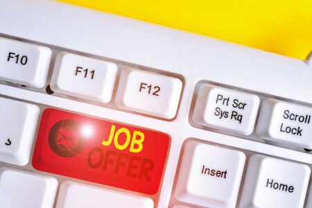 Text sign showing Job Offer. Business photo text A peron or company that gives opurtunity for one s is employment White pc keyboard with empty note paper above white background key copy space