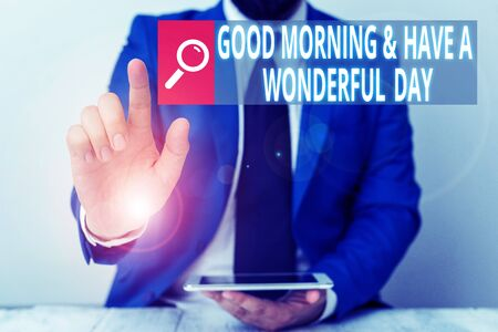 Writing note showing Good Morning And Have A Wonderful Day. Business concept for greeting someone in start of the day Businessman with pointing finger in front of him Banque d'images