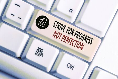 Handwriting text writing Strive For Progress Not Perfection. Conceptual photo Improve with flexibility Advance Grow White pc keyboard with empty note paper above white background key copy space