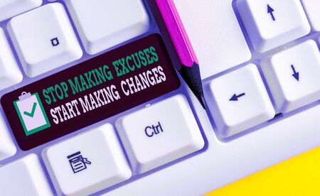 Writing note showing Stop Making Excuses Start Making Changes. Business concept for Do not give an excuse Act instead White pc keyboard with note paper above the white background