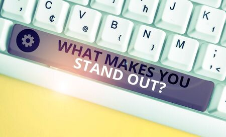 Conceptual hand writing showing What Makes You Stand Out Question. Concept meaning asking someone about his qualities White pc keyboard with note paper above the white background