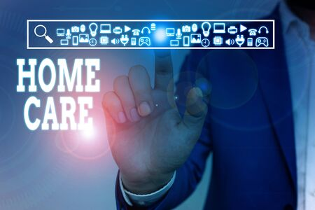 Writing note showing Home Care. Business concept for Place where showing can get the best service of comfort rendered Male wear formal work suit presenting presentation smart device Stok Fotoğraf