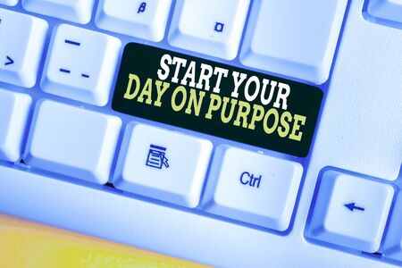 Writing note showing Start Your Day On Purpose. Business concept for Have clean ideas of what you are going to do White pc keyboard with note paper above the white background