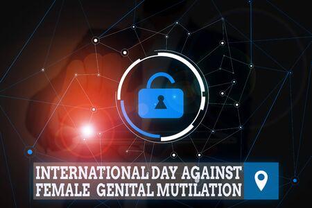 Conceptual hand writing showing International Day Against. Concept meaning International Day Against Female Genital Mutilation Male wear formal suit presenting presentation smart device Stock Photo