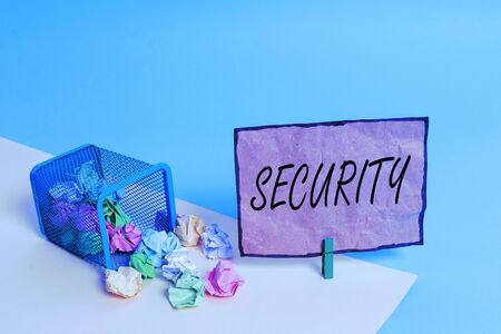 Handwriting text writing Security. Conceptual photo The state of feeling safe stable and free from fear or danger Trash bin crumpled paper clothespin empty reminder office supplies tipped
