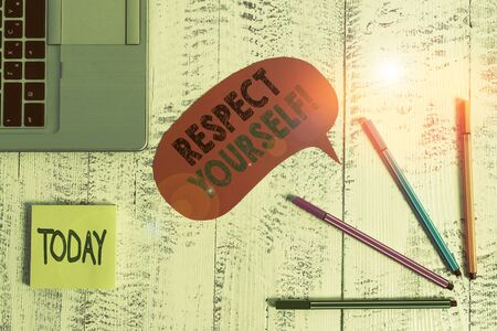 Text sign showing Respect Yourself. Business photo text believing that you good and worthy being treated well Open laptop speech bubble ballpoints sticky notes vintage wooden table