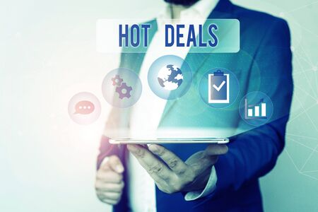 Text sign showing Hot Deals. Business photo text An agreement through which one of the paties is offered and accept Male human wear formal work suit presenting presentation using smart device