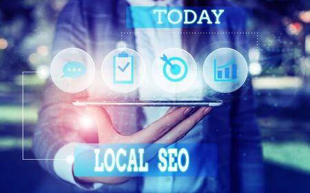Text sign showing Local Seo. Business photo showcasing This is an effective way of marketing your business online Female human wear formal work suit presenting presentation use smart device