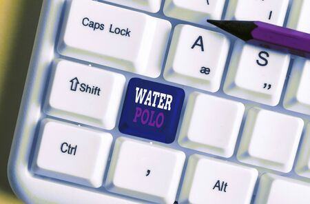 Text sign showing Water Polo. Business photo text competitive team sport played in the water between two teams White pc keyboard with empty note paper above white background key copy space