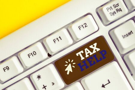 Writing note showing Tax Help. Business concept for Assistance from the compulsory contribution to the state revenue White pc keyboard with note paper above the white background