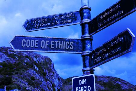 Word writing text Code Of Ethics. Business photo showcasing basic guide for professional conduct and imposes duties Road sign on the crossroads with blue cloudy sky in the background Foto de archivo