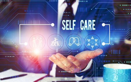 Text sign showing Self Care. Business photo showcasing Give comfort to your own body without professional consultant Male human wear formal work suit presenting presentation using smart device Stok Fotoğraf